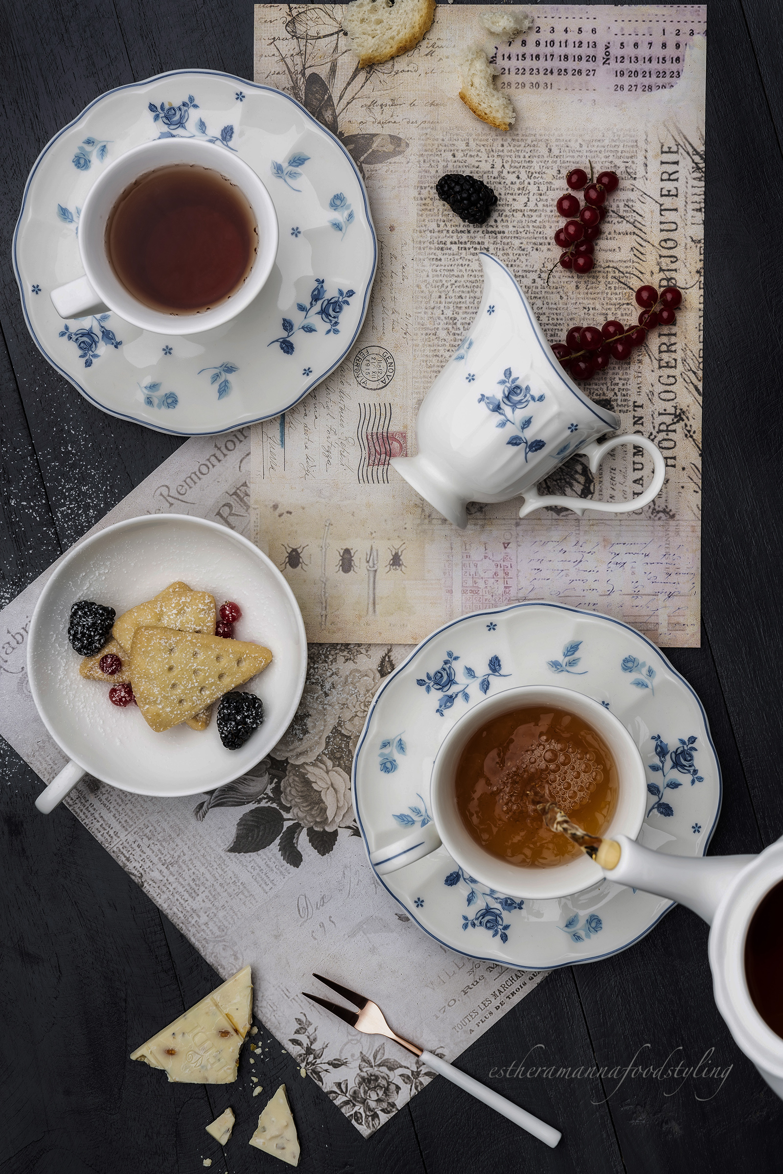 conceptual image for a high tea,Cookies,and floral cups,Foodstylist and foodstyling
