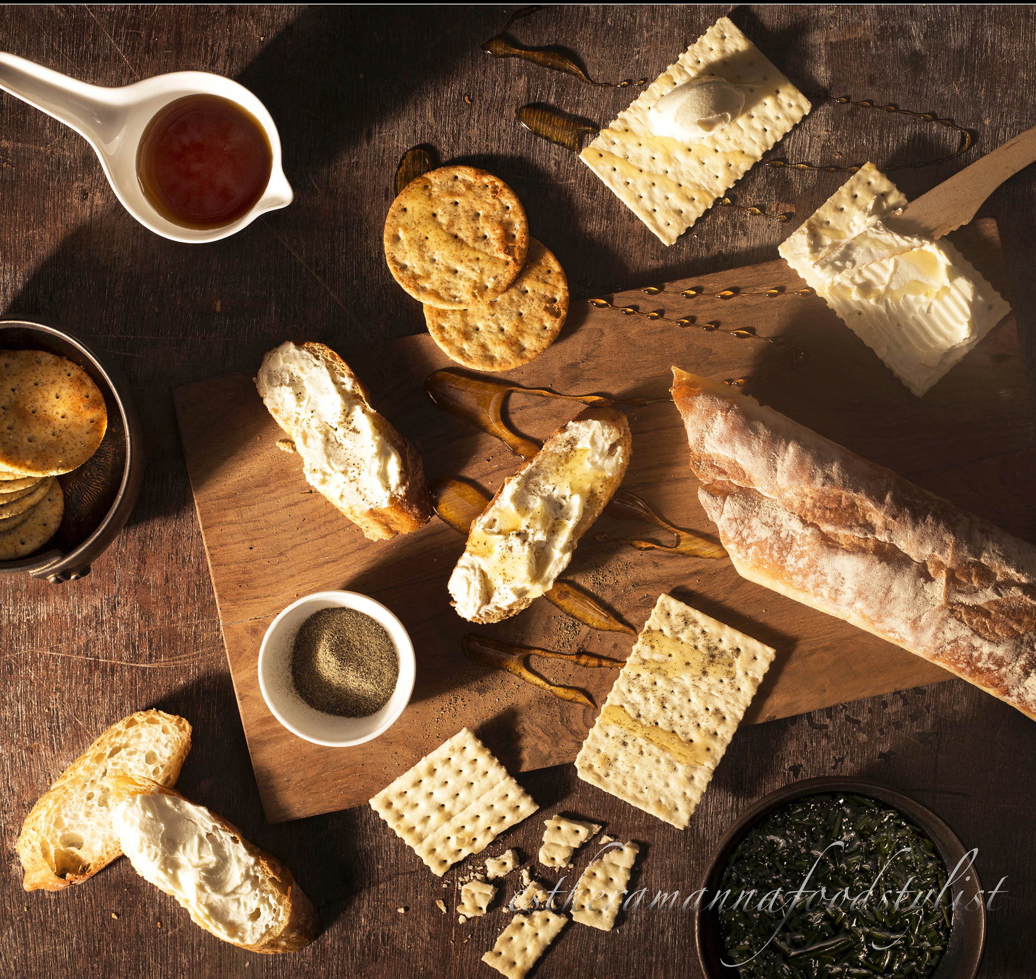 Breakfast spread with bread,cream cheese,honey and crackers,foodstyling,foodstylist Esther Amanna